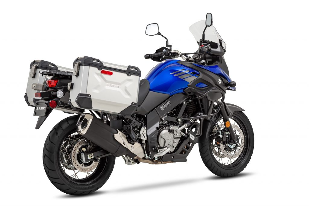 Rear-3/4 view of a blue-tanked 2020 Suzuki V-Strom 650XT Adventure with aluminum pannier bags