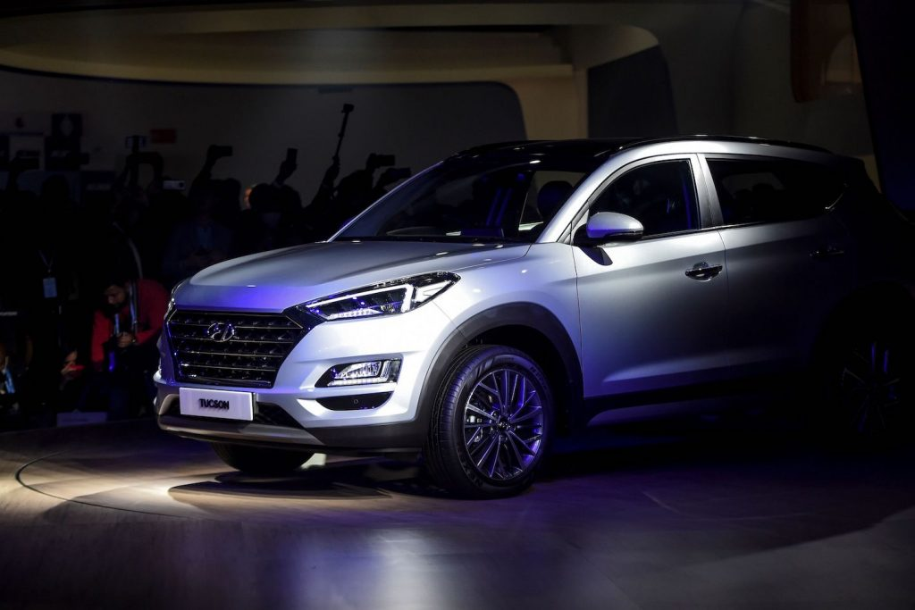 A silver 2020 Tucson is displayed on stage after its launch at the Auto Expo 2020