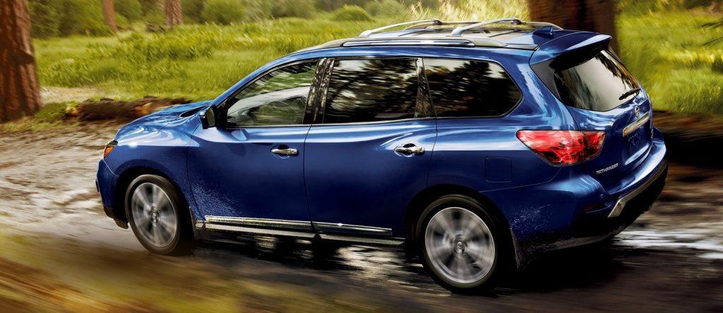 2020 Nissan Pathfinder driving on slick road