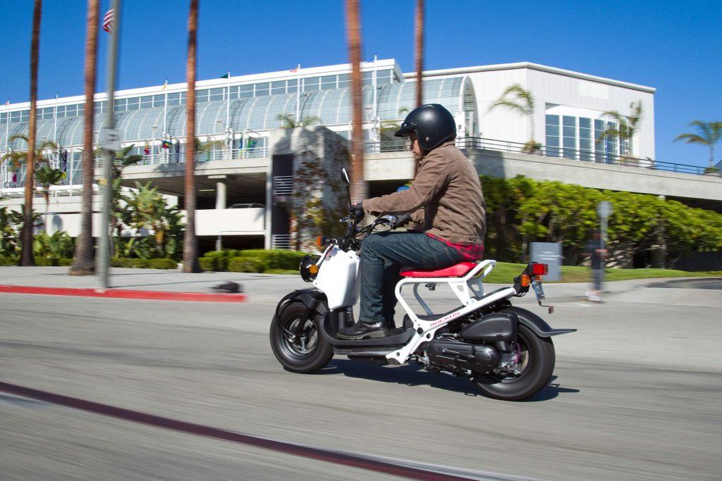 A man riding a Honda Ruckus
