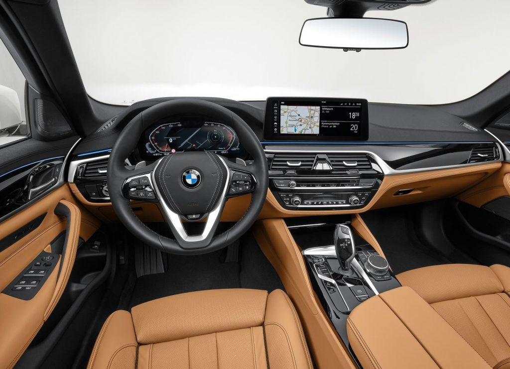 Interior shot of the 2021 BMW 5-Series, showing tan leather seats