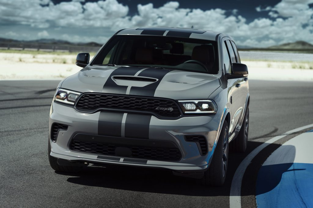 A gray Dodge Durango sits on the turn at a track.