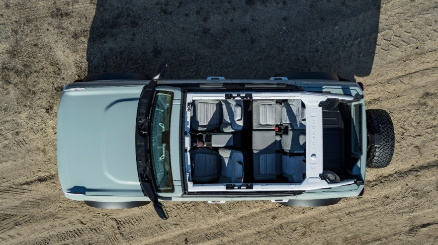 Overhead shot of a blue 2021 Ford Bronco with the roof and doors removed