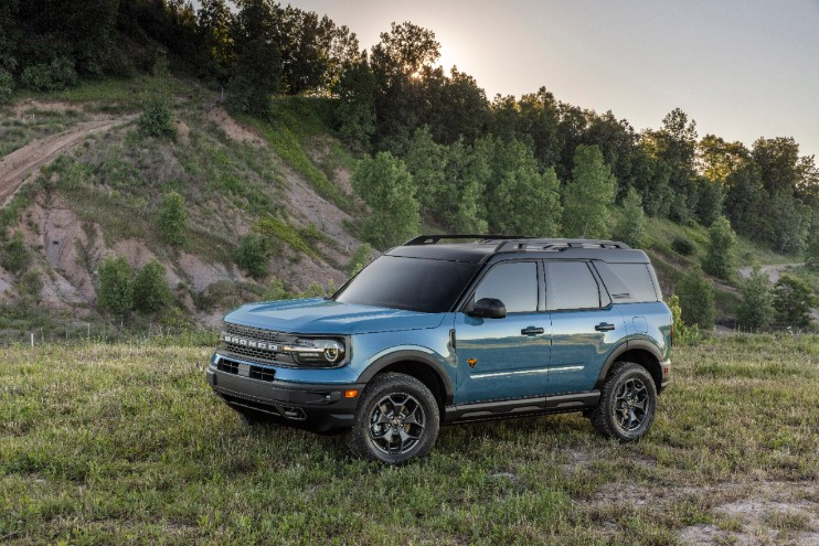 blue 4-door 2021 Ford Bronco Sport parked in grass on off-roading trail