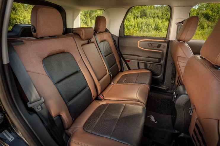 the rear seats of the 2021 Ford Bronco Sport in two tone brown leather