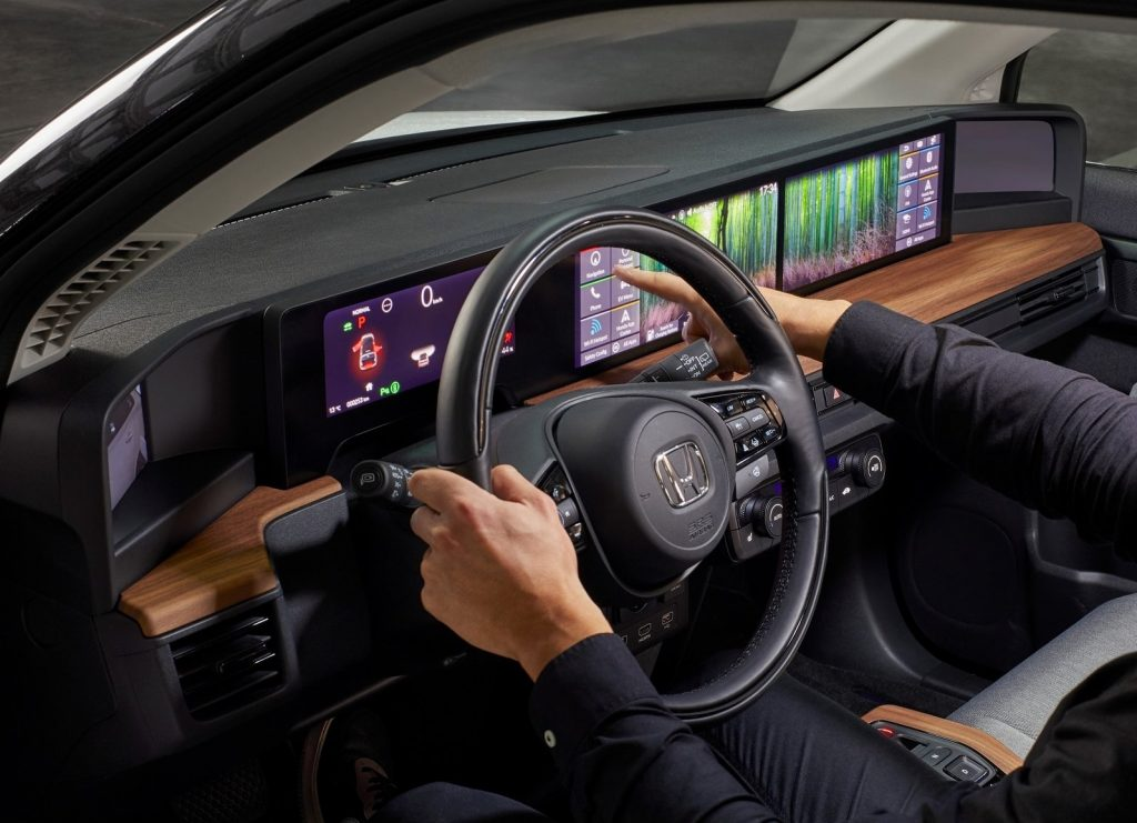 A close-up shot of the 2021 Honda E's dashboard, showing the configurable screens with a bamboo forest