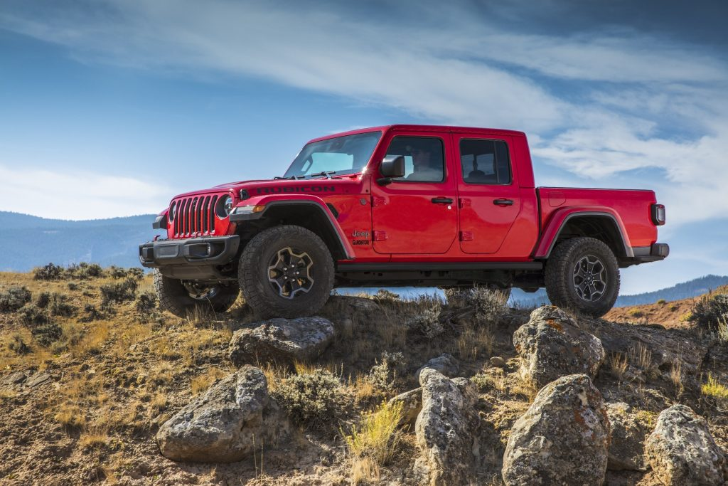 A red 2021 Jeep Gladiator sits atop of rocks.