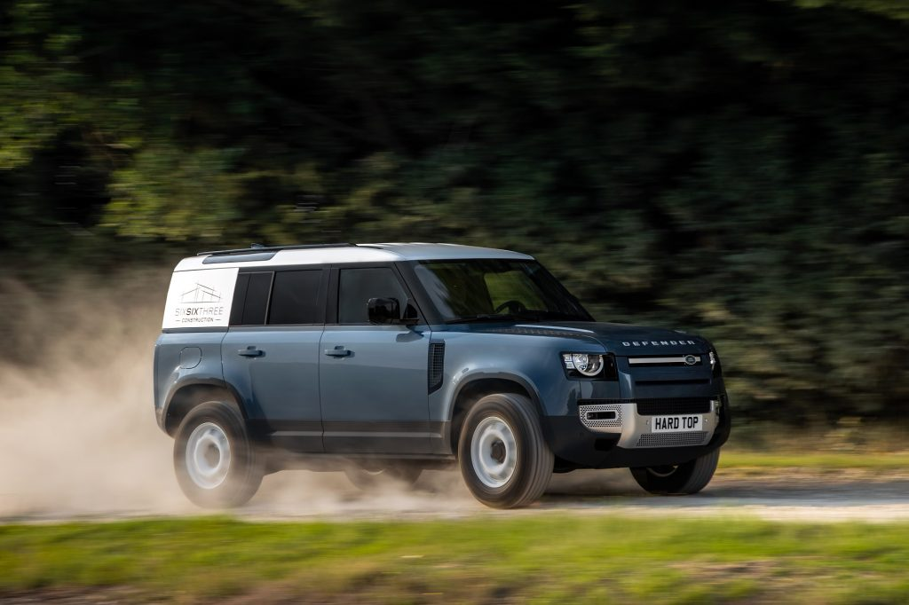 Blue 2021 Land Rover Defender Hard Top 110 panel van driving down a country road