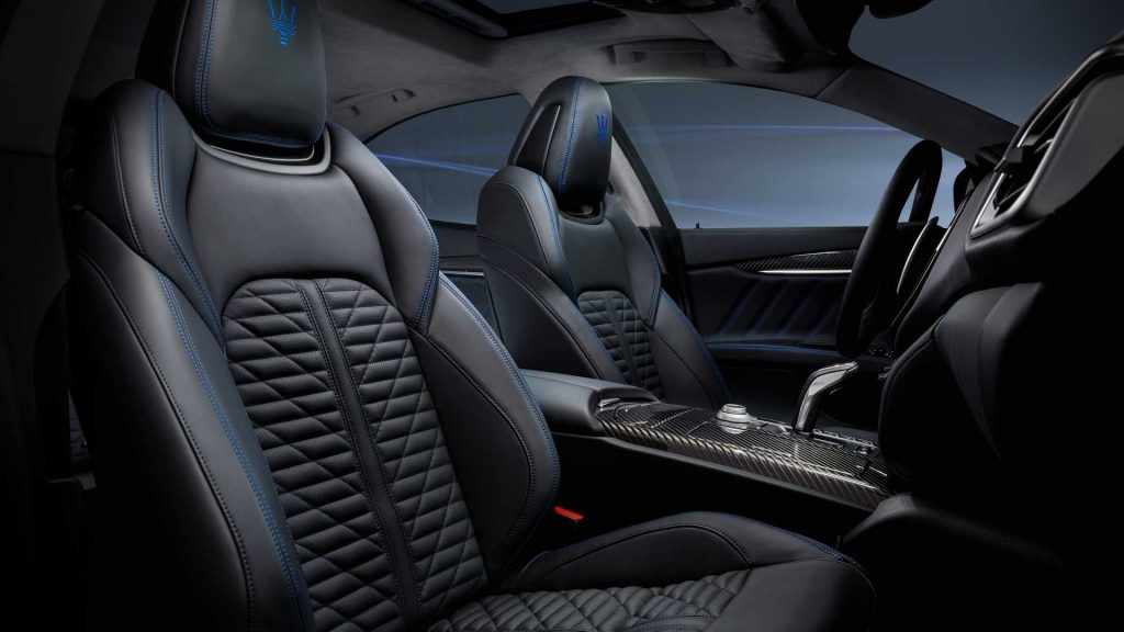 The front seating of the Maserati Ghibli shows the blue stitching.