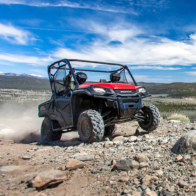 A Honda UTV do what it does best, going cross country over rough terrain
