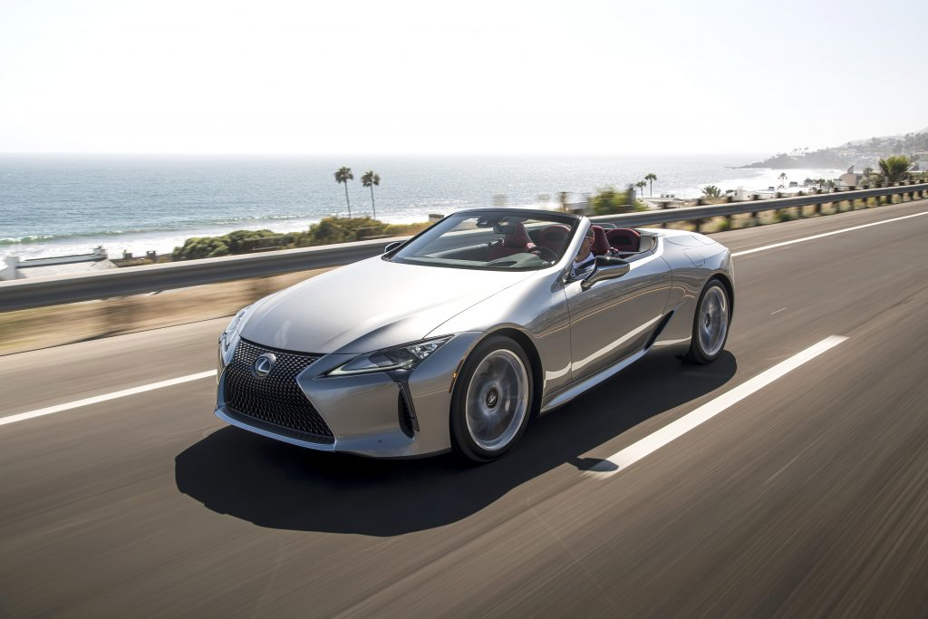 A silver, topless 2021 Lexus LC 500 on a coastal road.
