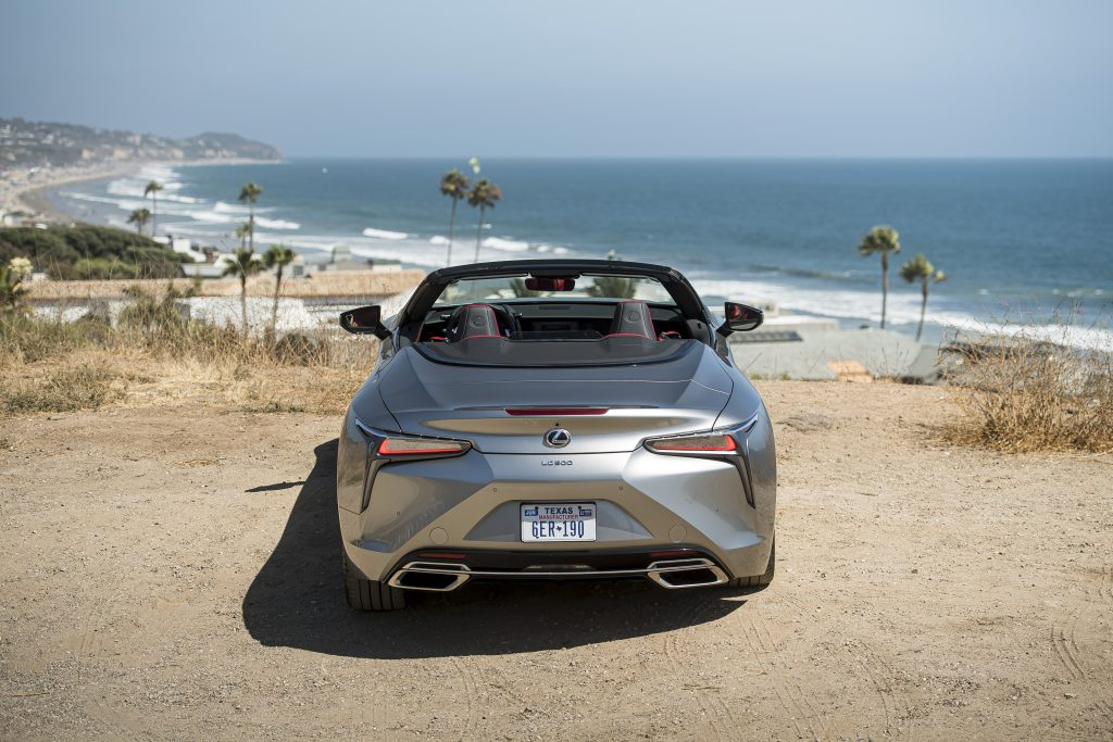 A silver, topless 2021 Lexus LC 500 Convertible is parked on the beach.