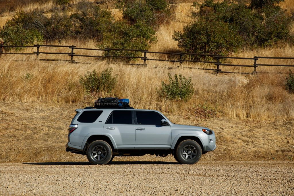 a trail edition 4runner SUV off-road in some hilly countryside