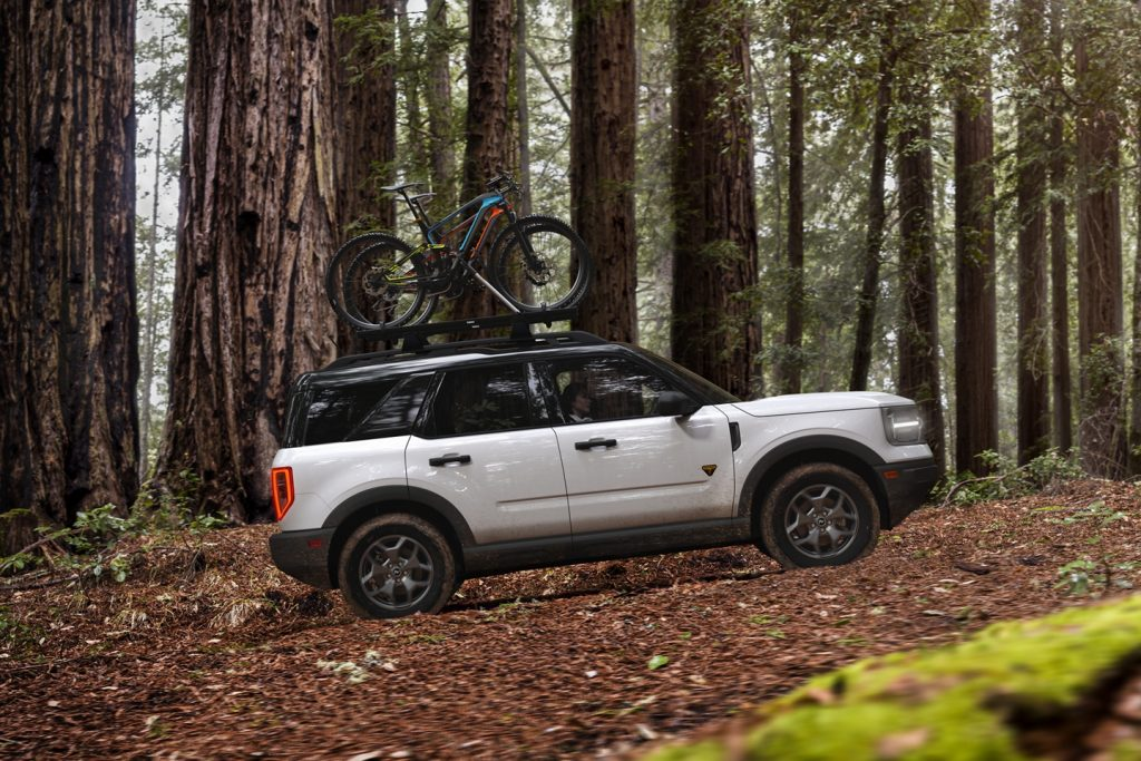 Ford Bronco Sport driving through the woods