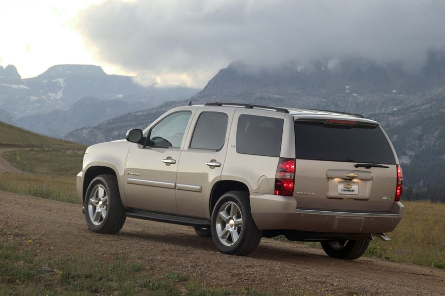 a gold 2010 used Chevy Tahoe in the mountains