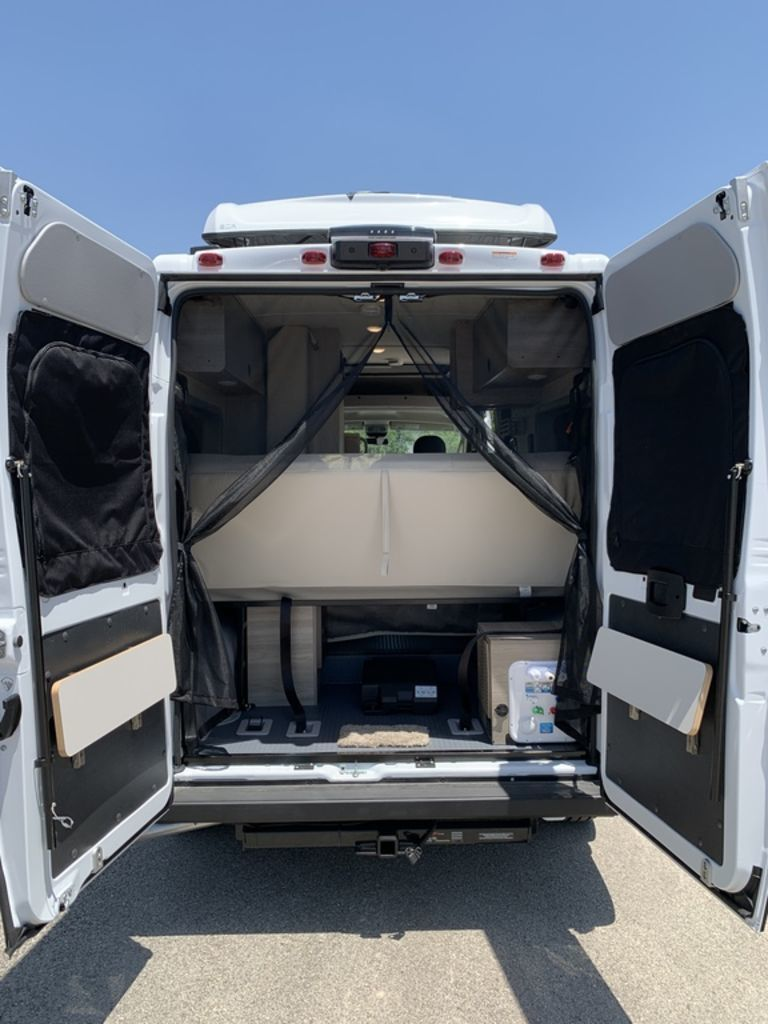 rear view of the interior of the Solis camper built on a Ram ProMater Chassis