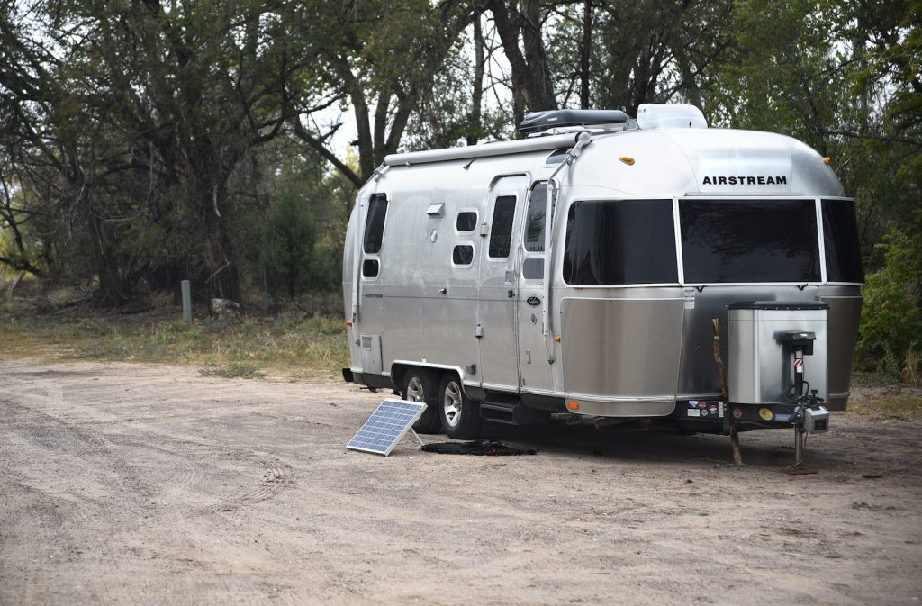 An Airstream travel trailer with a solar panel kit