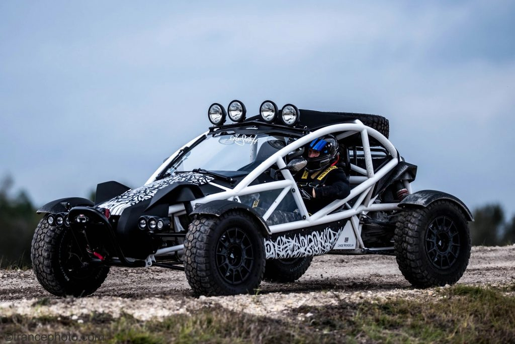 White-framed Ariel Nomad Tactical parked on a gravel road