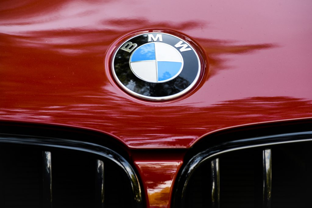 A BMW emblem is seen on a red car in Bucharest, Romania