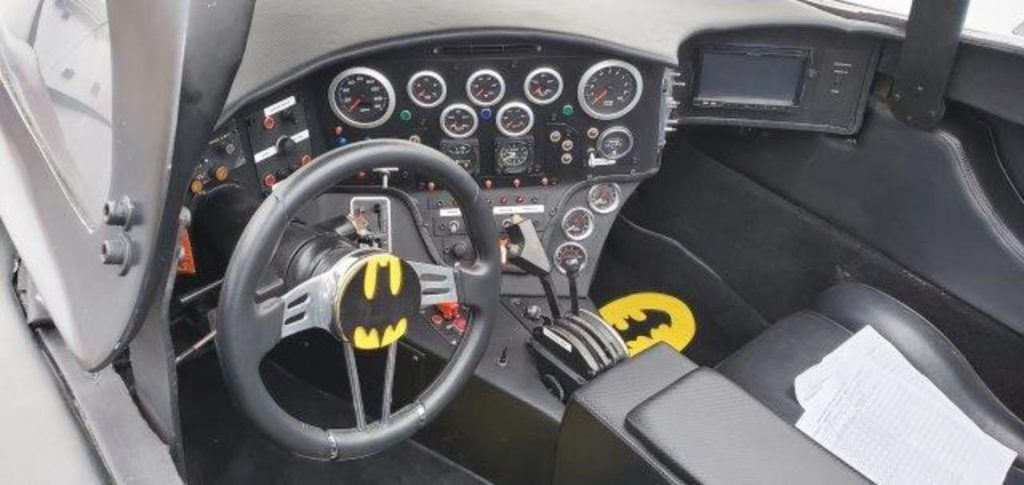 The interior of a Tim Burton Batmobile movie car replica.