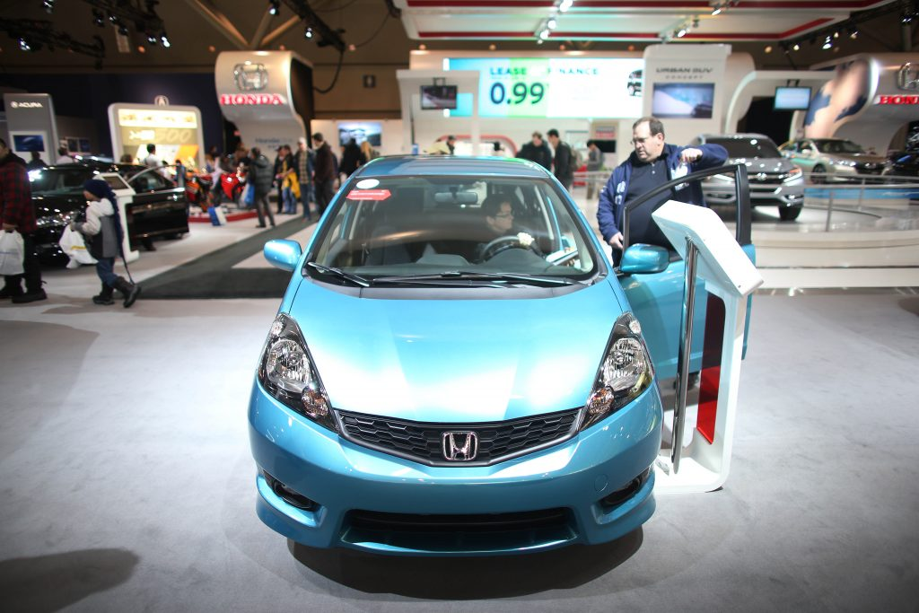A blue Honda Fit on display at an auto show