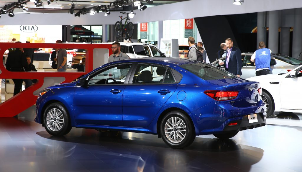 A blue Kia Rio on display at an auto show