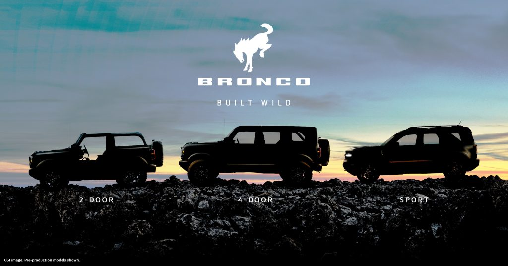 The silhouette of three SUVs against the sunrise.