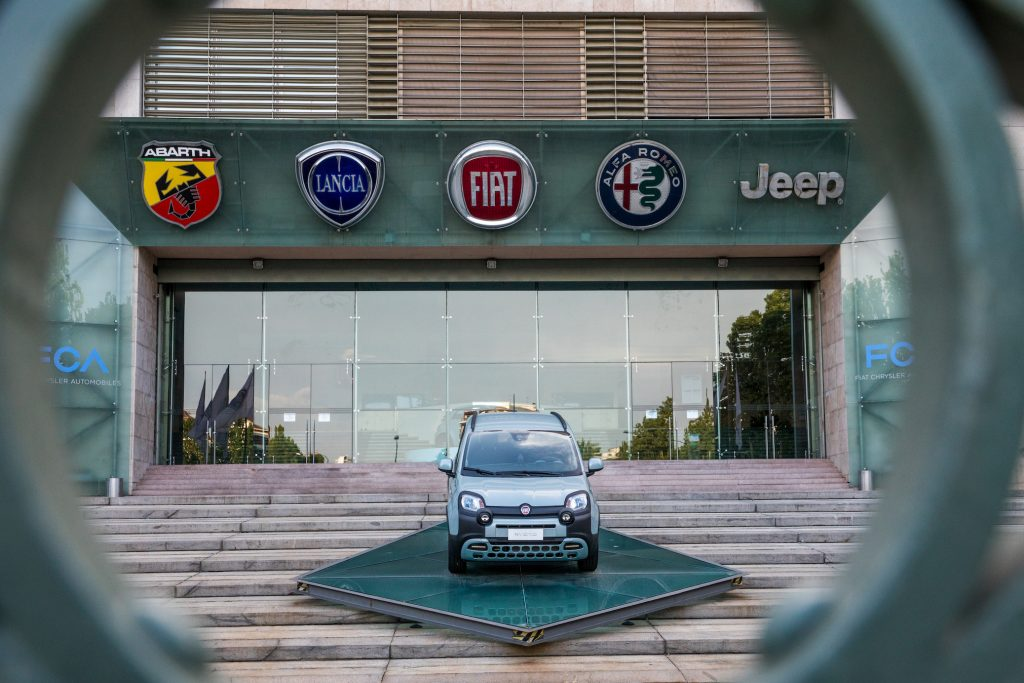 The logos of automobile companies (L-R) Abarth, Lancia, Fiat, Alfa Romeo and Jeep are pictured at the entrance to the Fiat Chrysler Automobiles (FCA)