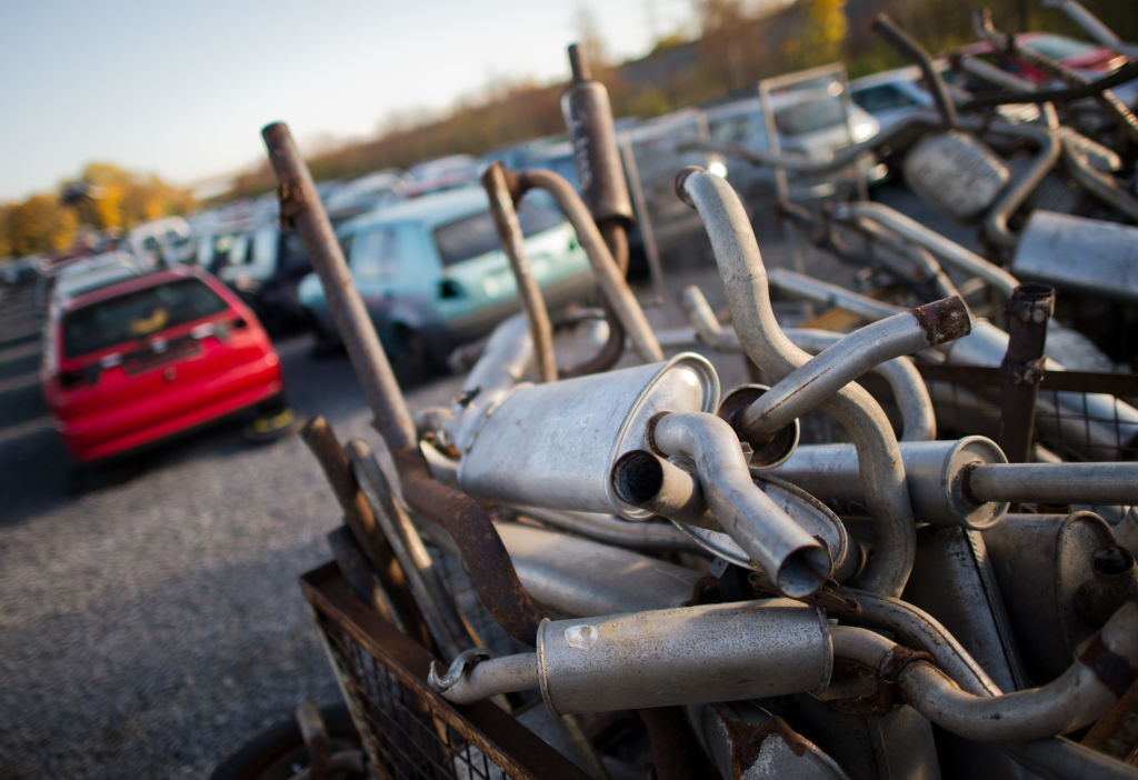 Old exhaust pipes lie in a junk yard |Julian Stratenschulte/picture alliance via Getty Images
