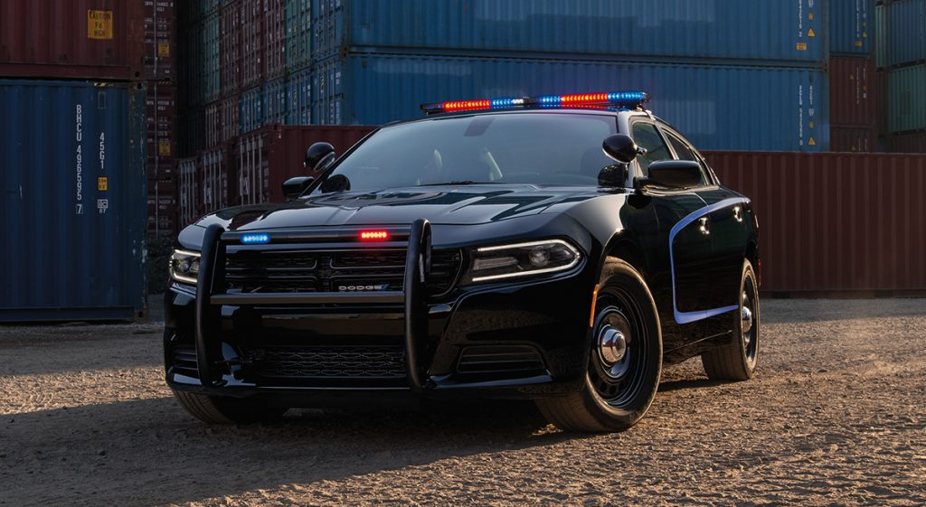 A look at the front of the a black Dodge Charger with a push bar.