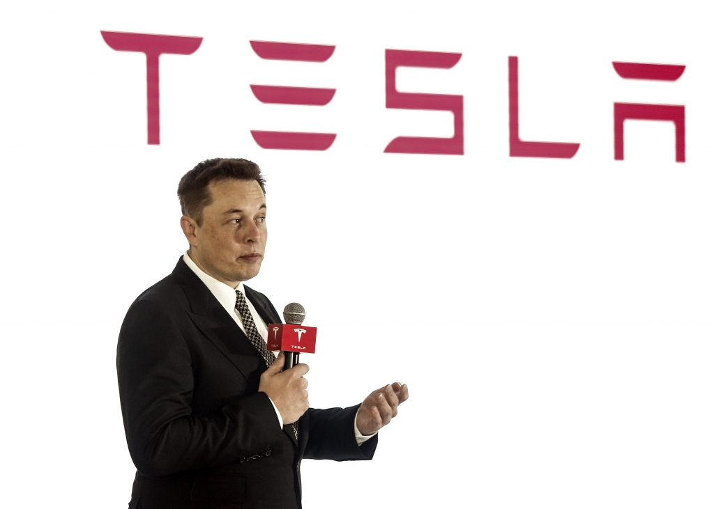 Elon Musk giving a talk at the new Tesla HQ in China