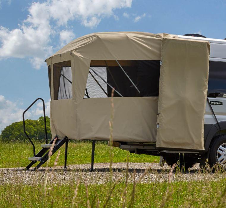 The rear of an RV has a porch tent platform.