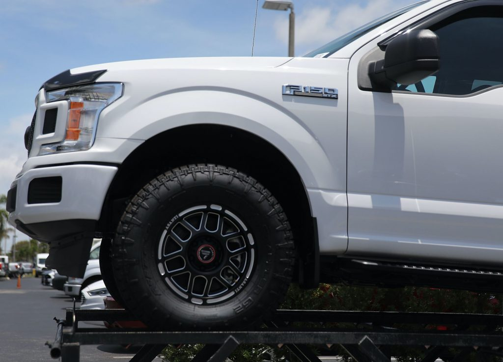 A Ford F-150 pickup truck – a competitor to the Chevy Silverado – is seen on a sales lot on May 10, 2018 in Miami, Florida.