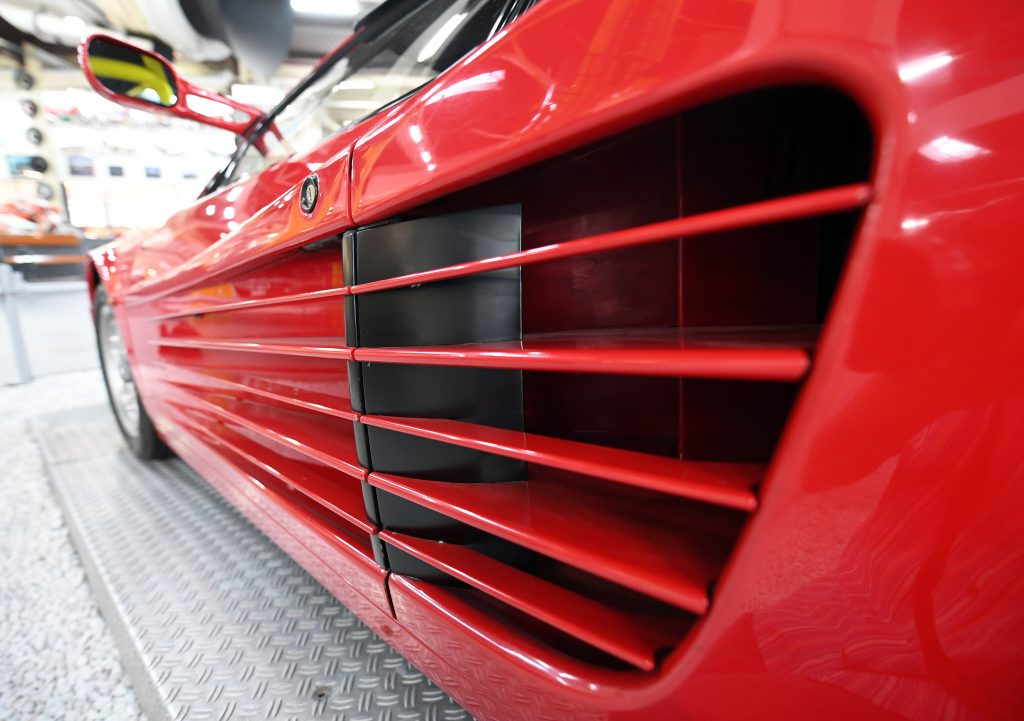 The drivers side door strakes leading to the air inlet for the engine or a red Ferrari Testarossa.