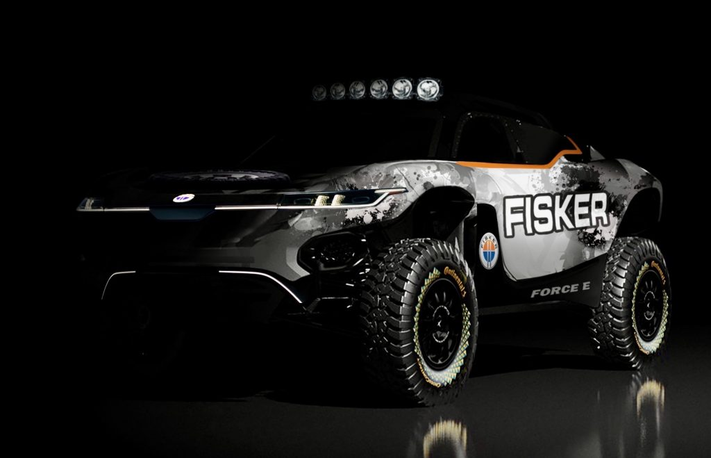 The Ocean racing SUV is seen from the front passenger side. The modified platform has race decals and special fenders.