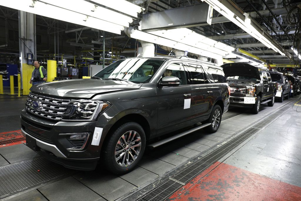 Factory workers assemble Ford Expeditions