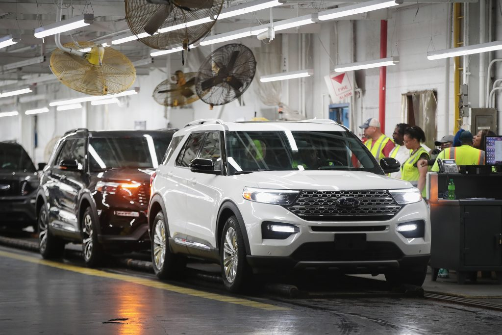 Ford Explorers being assembled in a plant