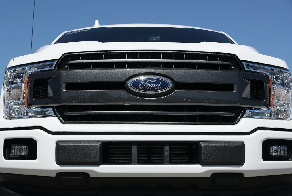 The front grill of a white Ford F-150 pickup truck is seen on Metro Ford's sales lot