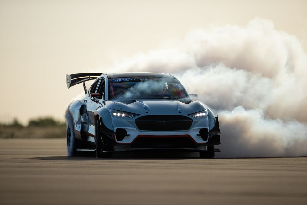 The prototype Ford Mustang Mach-E drag race car doing a sideways burnout