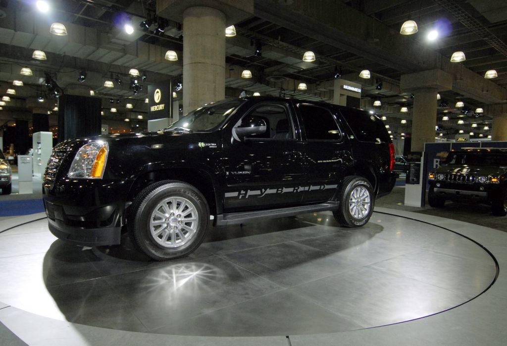 A GMC Yukon Hybrid on display at an auto show