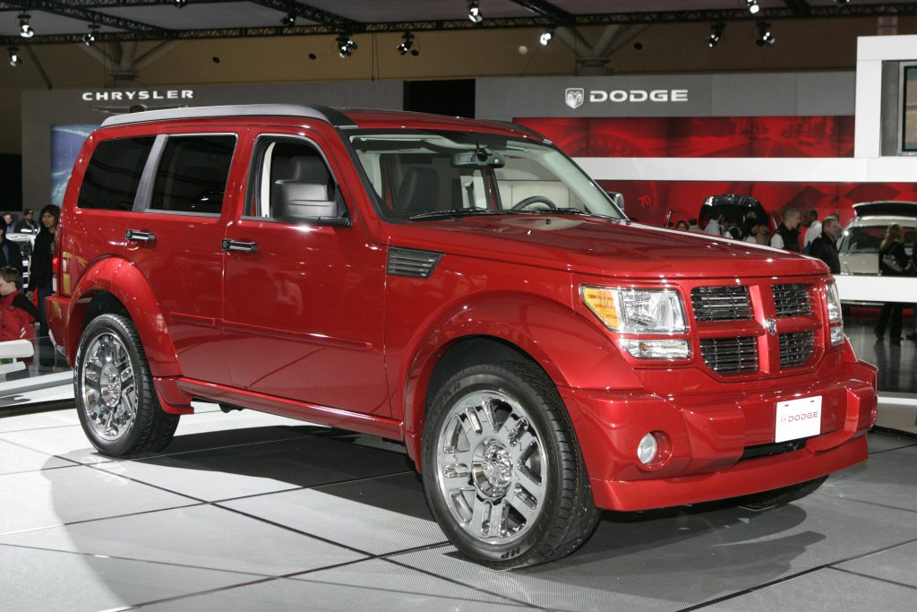 A red 2007 Dodge Nitro sits on display indoors.