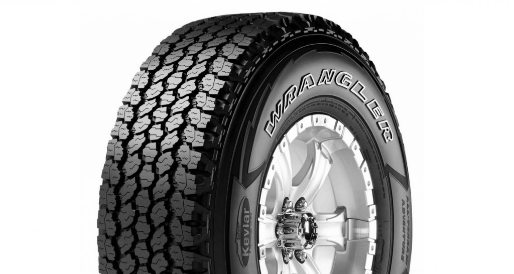 A single Goodyear Wrangler tire with outlined white letters