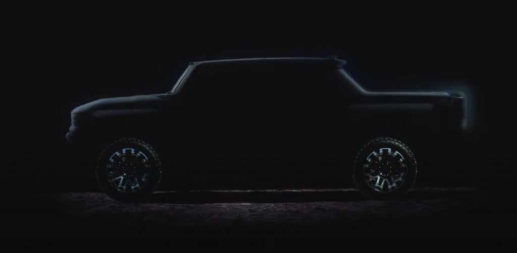 The outline of a GMC Hummer all-electric pickup is lit up on a black background.
