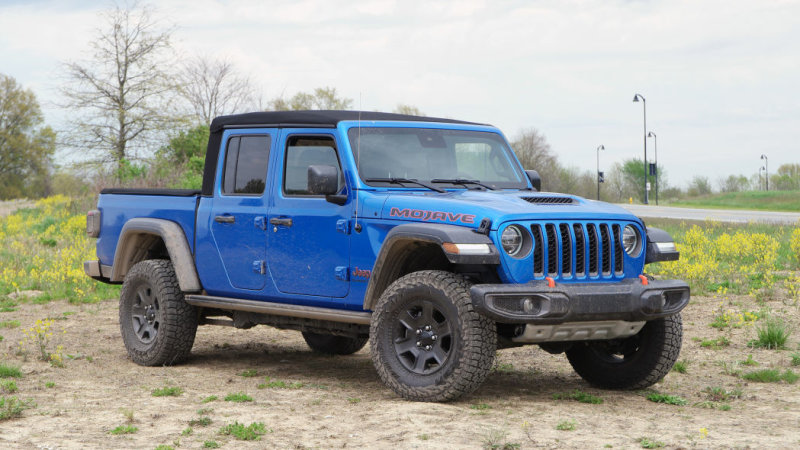 Hydro Blue Jeep Gladiator parked in sand