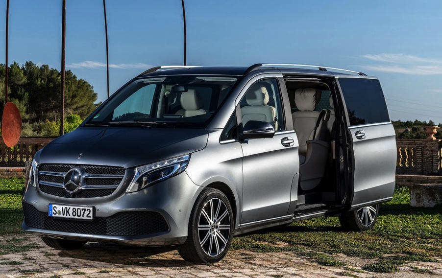 silver mercedes minivan with the sliding side door open to reveal a luxurious interior