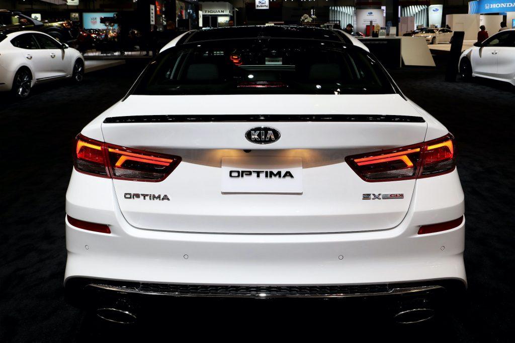 The rear of a white precursor of the 2020 Kia Optima on display at the Annual Chicago Auto Show