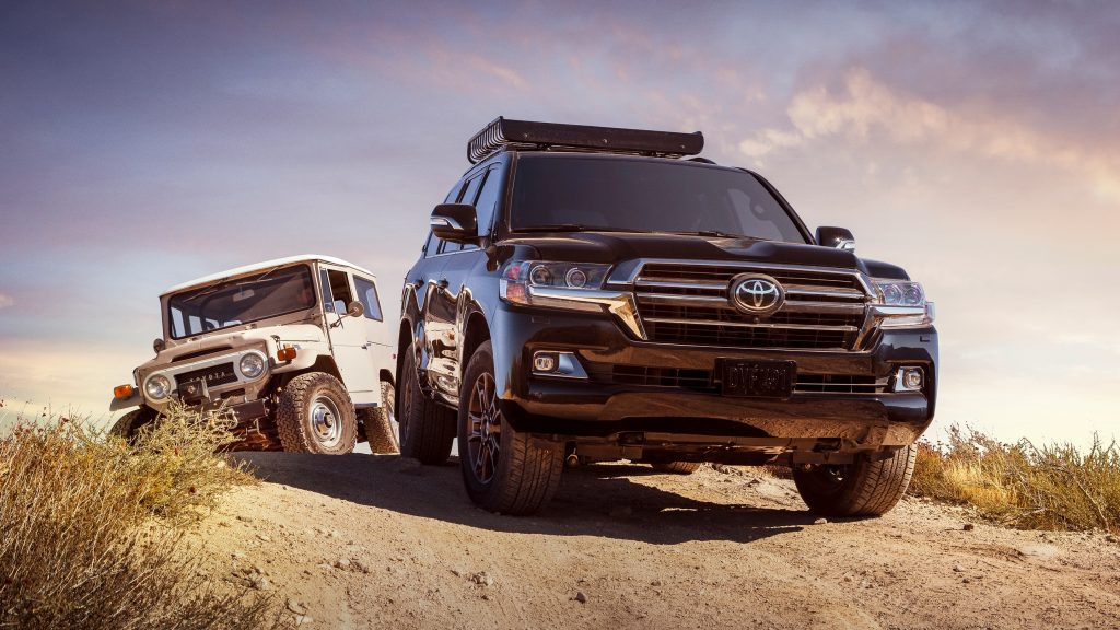 2020 Toyota Land Cruiser off-roading through sand with its robust V8 engine