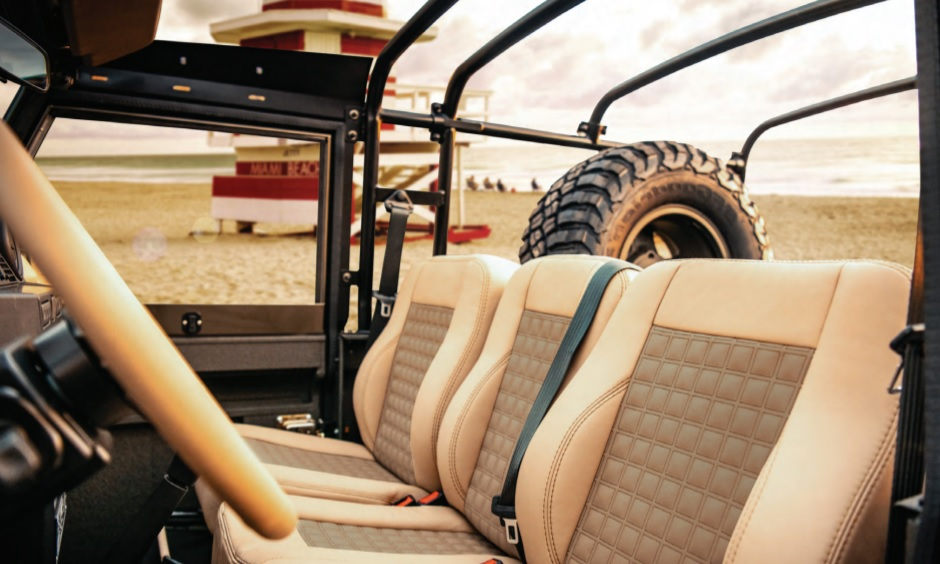 The electric Land Rover Defender NAS-E's tan leather interior, with the roof off