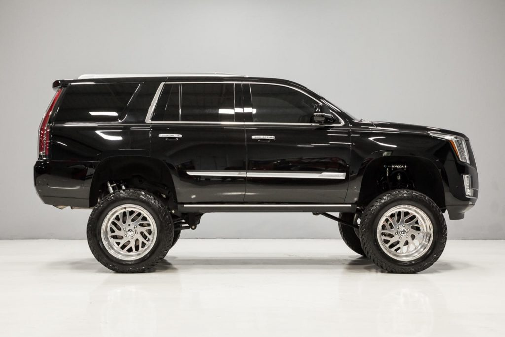 side view of black lifted 2017 Cadillac Escalade