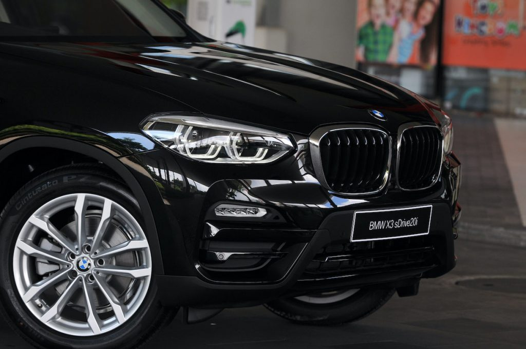 A look at a black BMW X3's front grille, a direct competitor to the Audi Q5